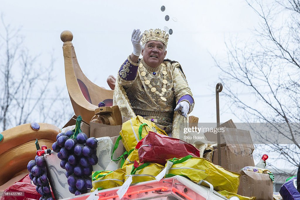Actor G.W. Bailey reigning as King of Bacchus tosses doubloons to fans and revelers in the 2013 Krewe of Bacchus Mardi Gras Parade on February 10, 2013 in New Orleans, Louisiana.