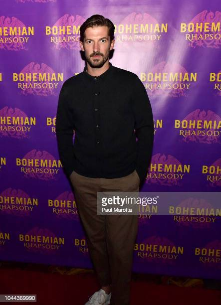 Actor Gwilym Lee who portrays Brian May walks the red carpet at the Boston red carpet screening of 'Bohemian Rhapsody' the film about the rock band...