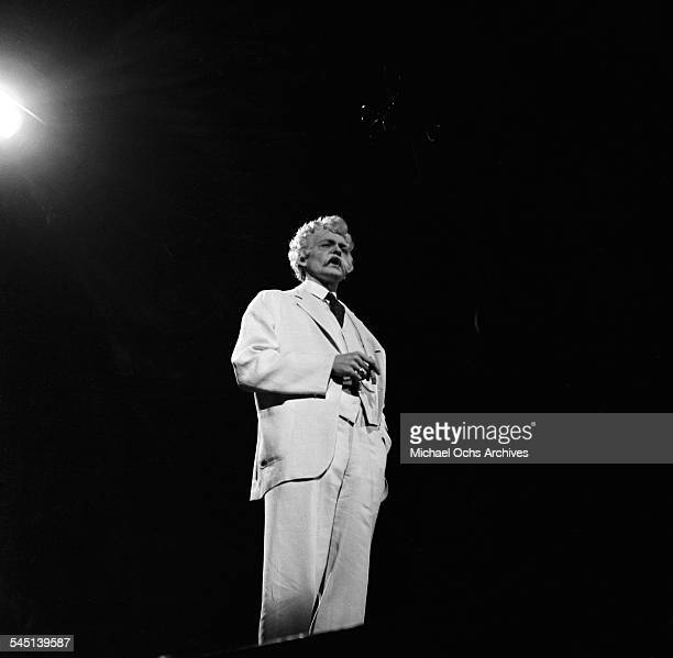 Actor Hal Holbrook performs on stage as Mark Twain on the Toast of the Town show hosted by Ed Sullivan at the Maxine Elliott Theater in New York New...