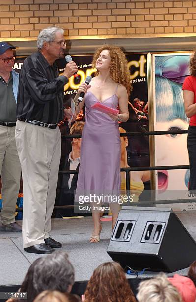 Actor Hal Linden talks with Actress Bernadette Peters during the Broadway Barks 4 dog and cat adoption event July 13 2002 in Shubert Alley in New...