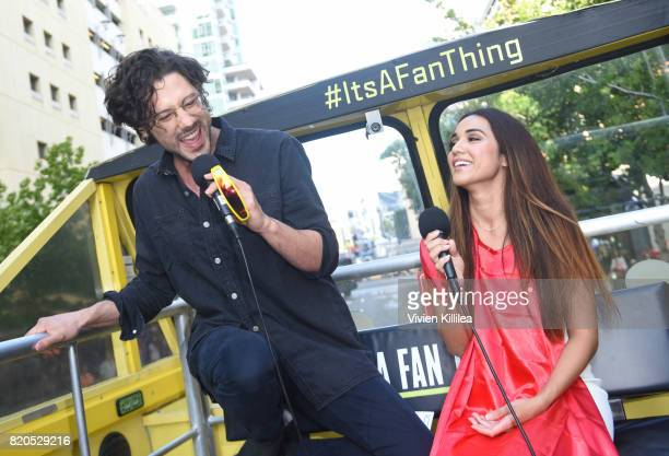 Actor Hale Appleman and actress Summer Bishil of The Magicians Surprise Fans and sing karaoke on the Karaoke Bus at San Diego Comic Con on July 21...