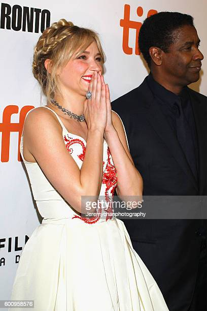 Actor Haley Bennett and actor Denzel Washington attend the 'The Magnificent Seven' premiere held at Roy Thomson Hall during the Toronto International...