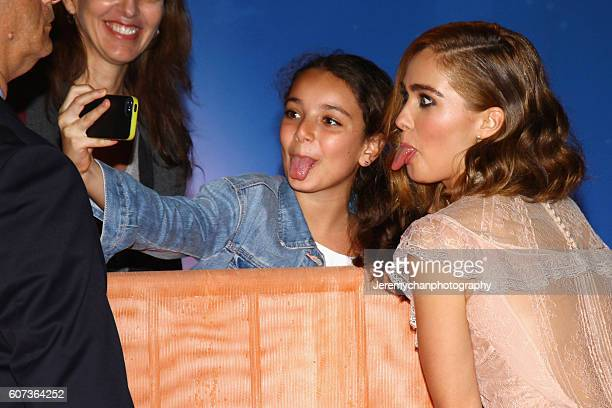 Actor Haley Lu Richardson takes a photo with a guest at the 'The Edge Of Seventeen' premiere held at Roy Thomson Hall during the Toronto...