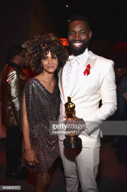 Actor Halle Berry and writer Tarell Alvin McCraney attend the 2017 Vanity Fair Oscar Party hosted by Graydon Carter at Wallis Annenberg Center for...