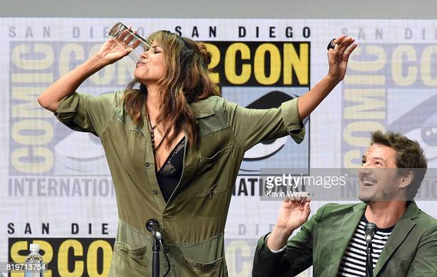 Actor Halle Berry takes a drink onstage while actor Pedro Pascal looks on at the 20th Century FOX panel during ComicCon International 2017 at San...