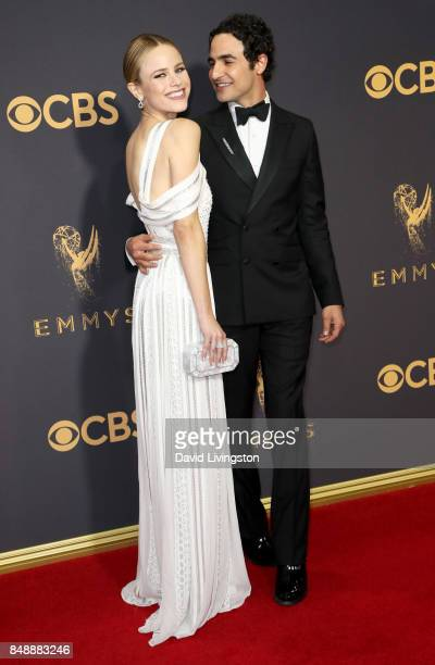 Actor Halston Sage and designer Zac Posen attend the 69th Annual Primetime Emmy Awards Arrivals at Microsoft Theater on September 17 2017 in Los...