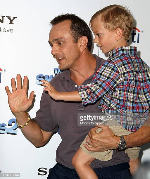 Actor Hank Azaria and son Hal Azaria attend The Smurfs 2 New York Blue Carpet Screening at Lighthouse International Theater on July 28 2013 in New...