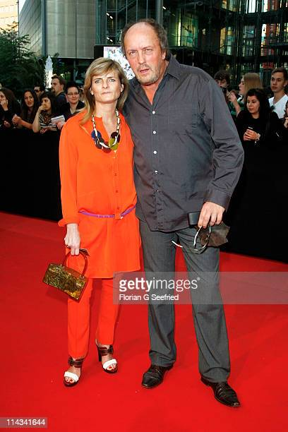 Actor Hans Werner Olm and girlfriend Cornelia Utz attend the 'Grand Opening Cinema Berlin' with the screening of 'Pirates Of The Caribbean: On...