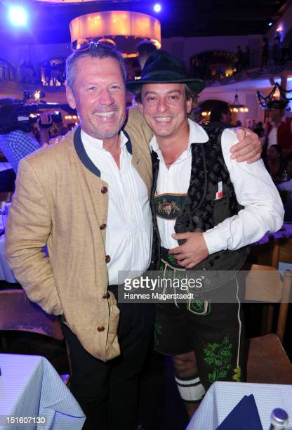 Actor Hansi Kraus and Florian Fischer attend the Angermaier WiesnFashion Show at the Loewenbraeukeller on September 8 2012 in Munich Germany