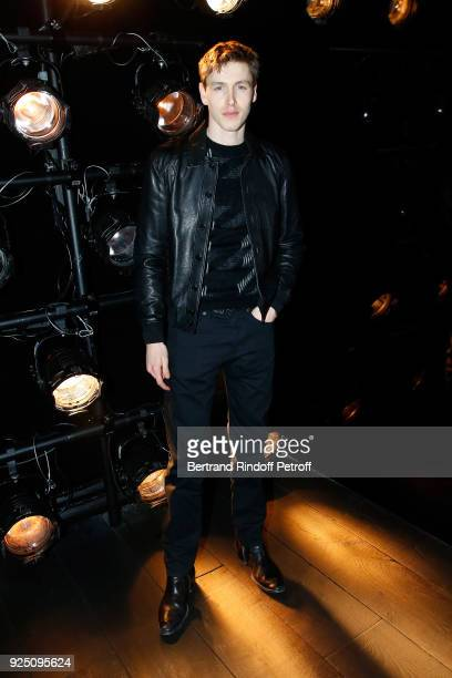 Actor Harris Dickinson attends the Saint Laurent show as part of the Paris Fashion Week Womenswear Fall/Winter 2018/2019 on February 27 2018 in Paris...