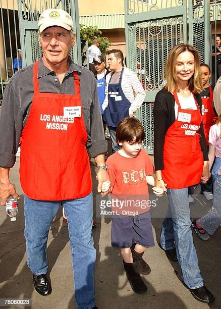 Actor Harrison Ford and actress Calista Flockhart with son Liam participate in serving Thanksgiving dinner to the Skid Row homeless at the Los...