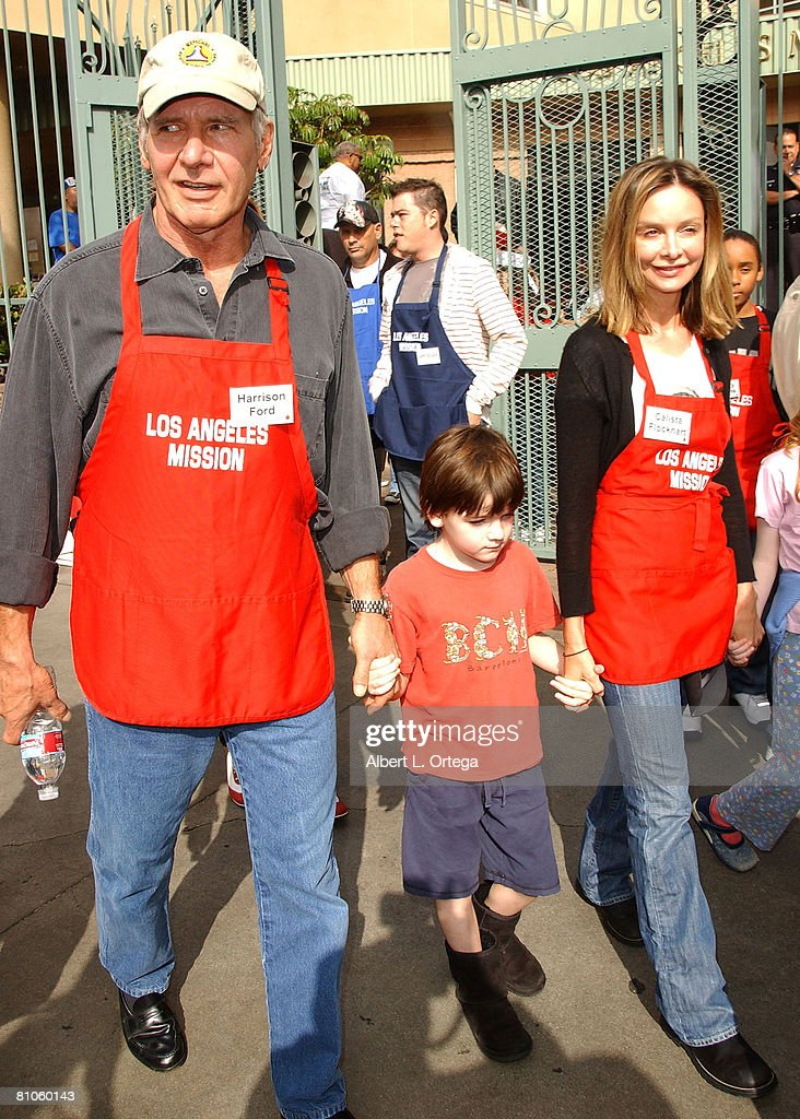 Actor Harrison Ford and actress Calista Flockhart with son Liam participate in serving Thanksgiving dinner to the Skid Row homeless at the Los Angeles Mission hosted by Kirk Douglas and Anne Douglas on November 21, 2007 in Downtown Los Angeles, California.