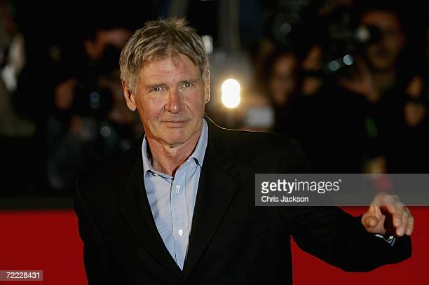 US actor Harrison Ford and Jim Berkus attend a red carpet for the Patricia McQueeney Award on the eighth day of Rome Film Festival on October 20 2006...