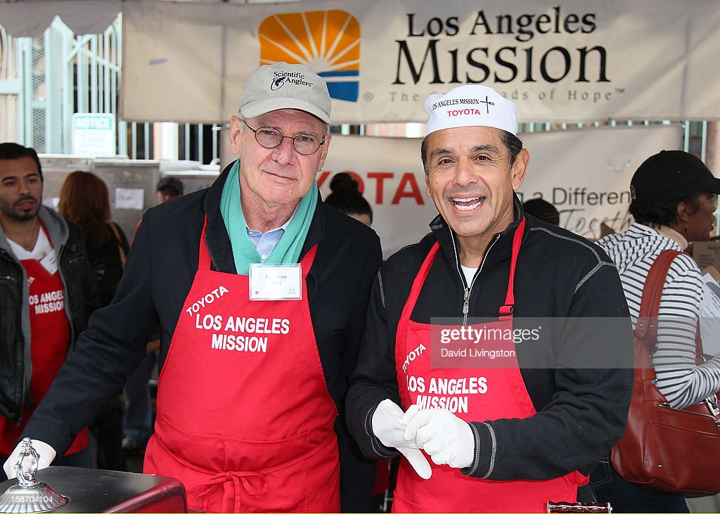 Actor Harrison Ford (L) and Los Angeles Mayor Antonio Villaraigosa attend the Los Angeles Mission's Christmas Eve for the homeless at the Los Angeles Mission on December 24, 2012 in Los Angeles, California.