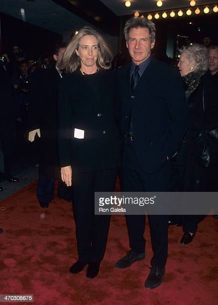 Actor Harrison Ford and wife Melissa Mathison attend the 'Kundun' New York City Premiere on December 11 1997 at Loews Astor Plaza in New York City