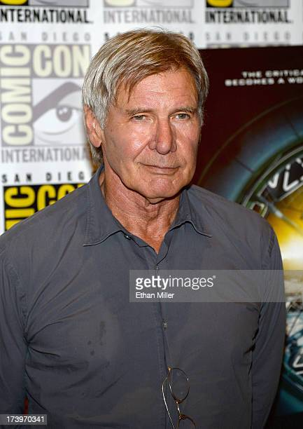 Actor Harrison Ford attends the Ender's Game and Divergent press line during ComicCon International 2013 at the Hilton San Diego Bayfront Hotel on...