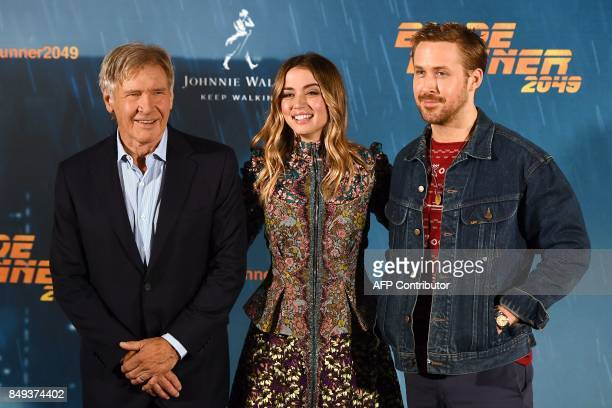 """Actor Harrison Ford, Cuban actress Ana de Armas and Canadian actor Ryan Gosling pose during the photocall of the film """"Blade Runner 2049"""" in Madrid..."""