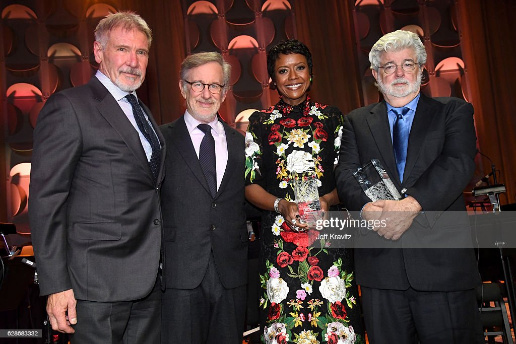 Actor Harrison Ford, founder, USC Shoah Foundation Steven Spielberg and honorees Mellody Hobson and George Lucas pose with awards onstage during Ambassadors for Humanity Gala Benefiting USC Shoah Foundation at The Ray Dolby Ballroom at Hollywood & Highland Center on December 8, 2016 in Hollywood, California.