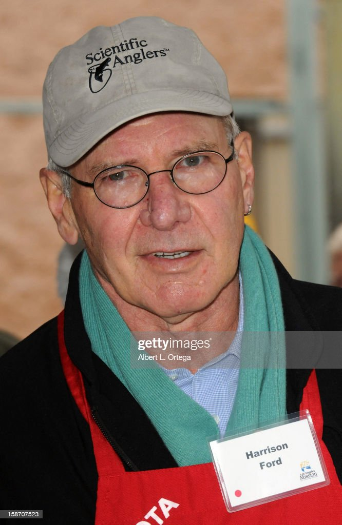 Actor Harrison Ford participates in the Los Angeles Mission Christmas Eve lunch For The Homeless held at the Los Angeles Mission on December 24, 2012 in Los Angeles, California.