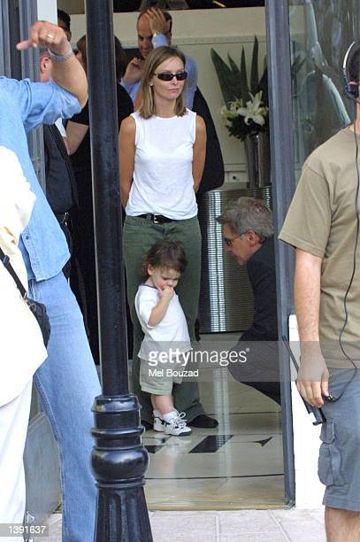 Actor Harrison Ford plays with actress Calista Flockhart's son Liam as she watches on September 17 2002 in Beverly Hills California