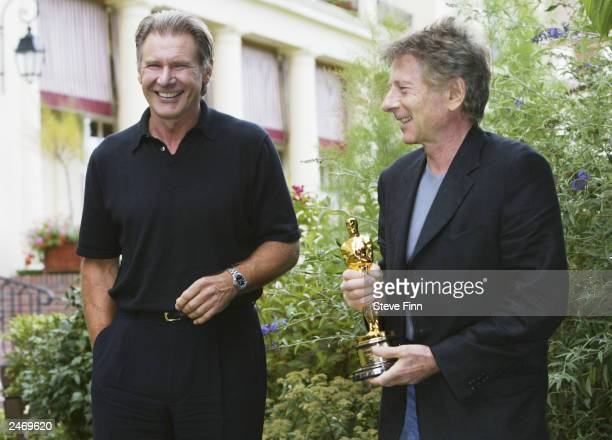 Actor Harrison Ford presents director Roman Polanski with his Oscar at the 29th American Film Festival in Deauville on September 7 2003 in Deauville...