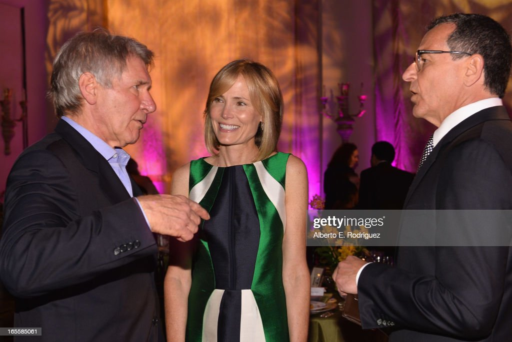 Actor Harrison Ford, Senior Editor of The Huffington Post Willow Bay and Chairman and CEO of The Walt Disney Company Bob Iger attend Conservation International's 17th Annual Los Angeles Dinner at Montage Beverly Hills on April 4, 2013 in Beverly Hills, California.