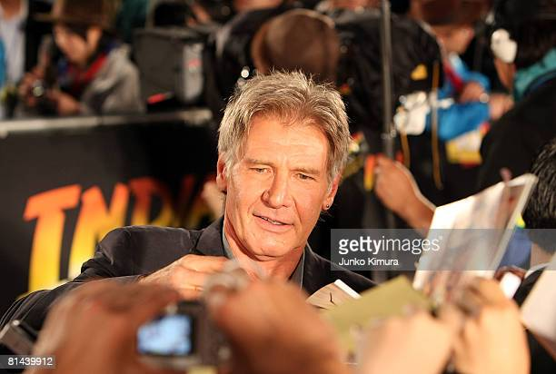 Actor Harrison Ford signs an autograph during the 'Indiana Jones and the Kingdom of the Crystal Skull' Japan Premiere at the National Yoyogi...