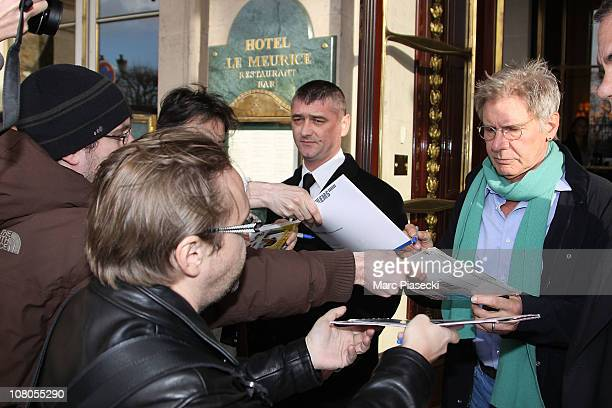 Actor Harrison Ford signs autographs as he leaves the 'Meurice' hotel on January 15 2011 in Paris France