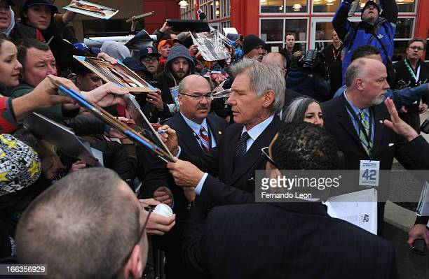 Actor Harrison Ford signs autographs before the screening of '42' at AMC Barrywoods on April 11 2013 in Kansas City Missouri