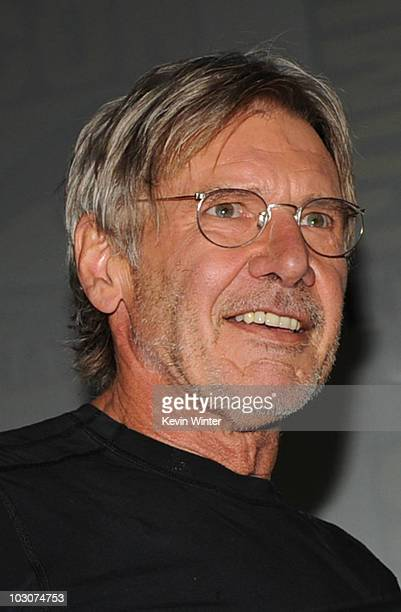 Actor Harrison Ford walks onstage at the 'Cowboys Aliens' panel discussion during ComicCon 2010 at San Diego Convention Center on July 24 2010 in San...