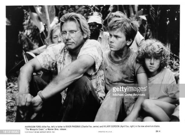 Actor Harrison Ford with actress Helen Mirren actor River Phoenix and actress Hilary Gordon on the set of Warner Bros movie 'The Mosquito Coast' in...