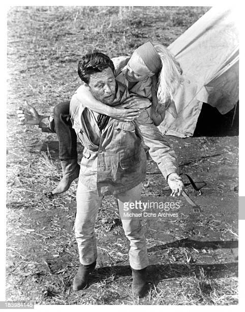 Actor Harry Guardino and actress Shirley Eaton on the set of the movie Rhino in 1964