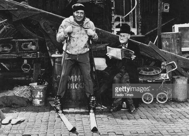 Actor Harry H Corbett wearing skiing clothing as Wilfrid Brambell looks on in a scene from episode 'A Winter's Tale' of the television sitcom the...