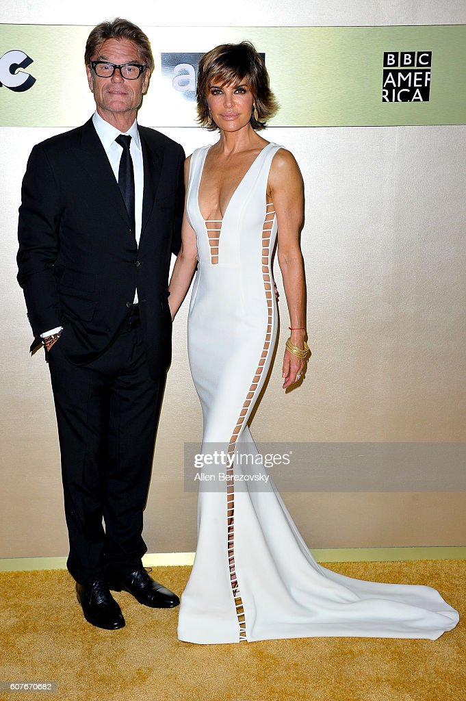Actor Harry Hamlin and actress Lisa Rinna attend AMC Networks' 68th Primetime Emmy Awards after-party celebration at BOA Steakhouse on September 18, 2016 in West Hollywood, California.