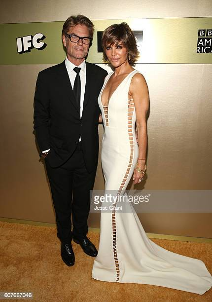 Actor Harry Hamlin and actress Lisa Rinna attends AMC Networks Emmy Party at BOA Steakhouse on September 18 2016 in West Hollywood California