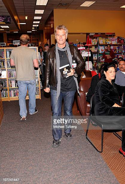 Actor Harry Hamlin arrives at a signing event for his and wife Lisa Rinna's new books Full Frontal Nudity and Starlit on December 1 2010 in Sherman...
