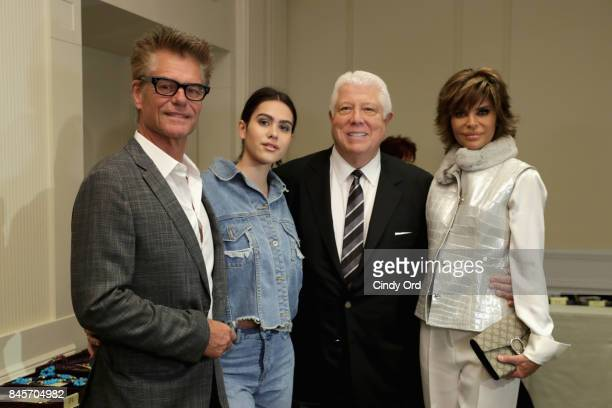 Actor Harry Hamlin model Amelia Gray Hamlin designer Dennis Basso and actress Lisa Rinna backstage at Dennis Basso fashion show during New York...