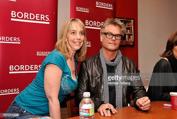Actor Harry Hamlin poses with a fan at a signing event for his and wife Lisa Rinna's new books Full Frontal Nudity and Starlit on December 1 2010 in...