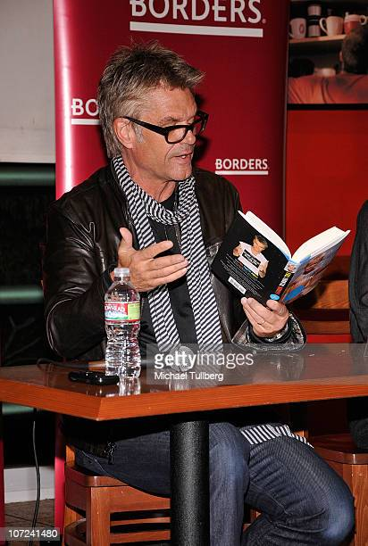 Actor Harry Hamlin speaks at a signing event for his and wife Lisa Rinna's new books Full Frontal Nudity and Starlit on December 1 2010 in Sherman...