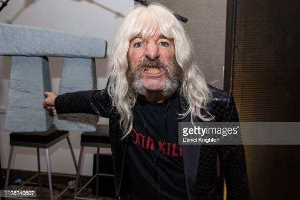 Actor Harry Shearer appears at the Ampeg booth in character as bassist Derek Smalls of Spinal Tap with a miniature model of Stonehenge during the...