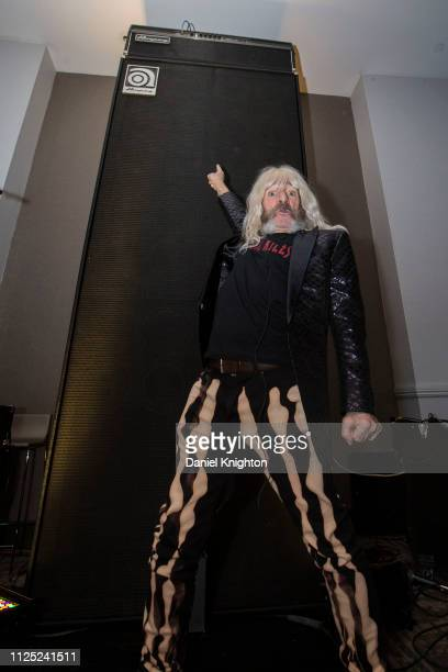 Actor Harry Shearer appears at the Ampeg booth in character as bassist Derek Smalls of Spinal Tap during the 2019 NAMM Show at Anaheim Convention...