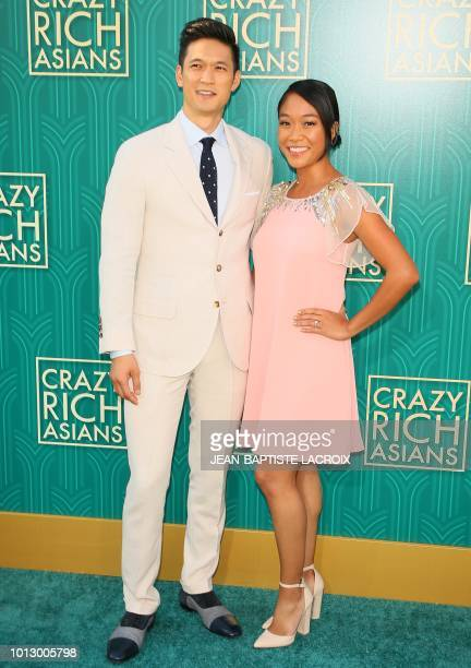 Actor Harry Shum Jr and his wife actress Shelby Rabara attend the premiere of Warner Bros Pictures' 'Crazy Rich Asians' in Hollywood California on...