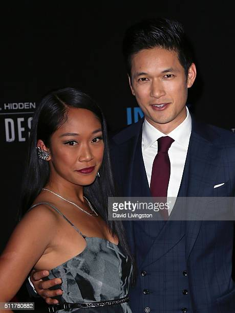 Actor Harry Shum Jr and wife actress Shelby Rabara attend the premiere of Netflix's Crouching Tiger Hidden Dragon Sword of Destiny at AMC Universal...
