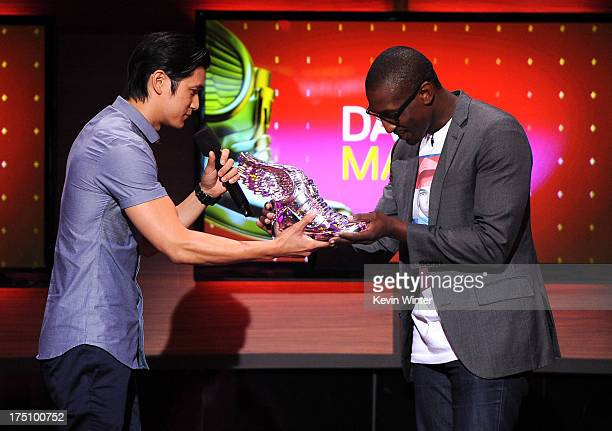 Actor Harry Shum, Jr. Presents award to Daniel Maree of Million Hoodies Movement for Justice onstage at the DoSomething.org and VH1's 2013 Do...