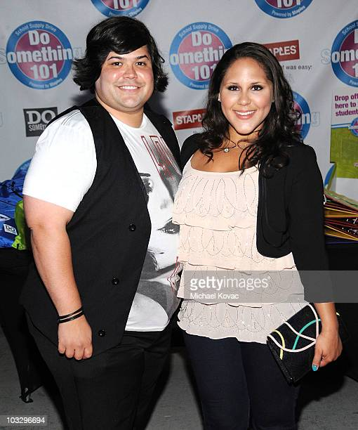 Actor Harvey Guillen and actress Ashley Holliday arrive at the Do Something 101 Back Pack Party at The Globe Theatre at Universal Studios on August 8...
