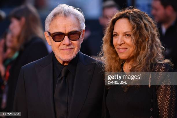 US actor Harvey Keitel and his wife Canadian actor Daphna Kastner arrive to attend the international premiere of the film The Irishman during the...