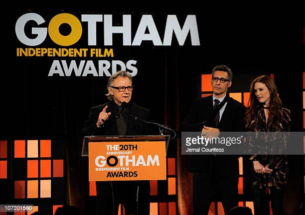 Actor Harvey Keitel presents onstage as actors John Turturro and Julianne Moore look on at IFP's 20th Annual Gotham Independent Film Awards at...