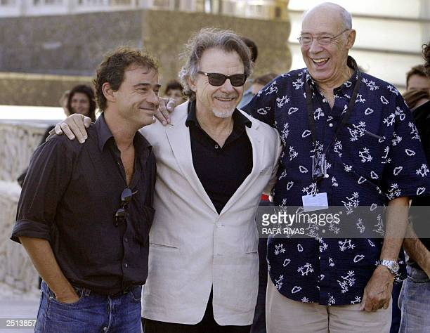 US actor Harvey Keitel Spanish film director Gerardo Herrero and Cuban actor Reynaldo Miravalles pose for photographers 20 September 2003 in the...