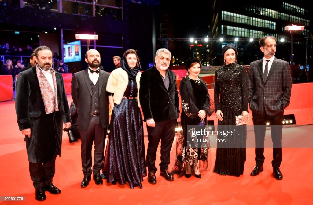 Actor Hasan Majuni, Iranian actor Ali Mosaffa, Iranian actress Leila Hatami, Iranian producer Mani Haghighi, Iranian actress Leili Rashidi, Iranian actress Parinaz Izadyar and Iranian actor Ali Bagheri pose on the red carpet before the premiere of the film 'Pig' (Khook) presented in competition during the 68th edition of the Berlinale film festival in Berlin on February 21, 2018. / AFP PHOTO / Stefanie Loos