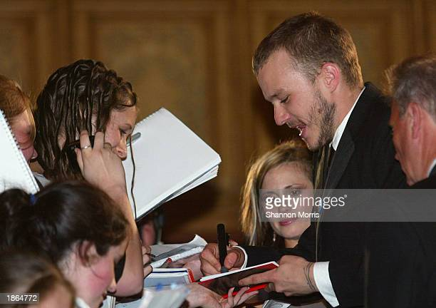 Actor Heath Ledger signs autographs as he arrives for the World Premiere of the film Ned Kelly March 22 2003 at the Regent Theatre in Melbourne...
